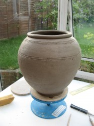 When it has dried enough to handle, I think this pot will have a tidy heft to it