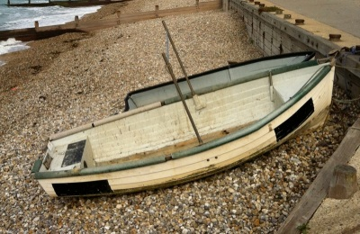 ... with small boats drawn up on the shingle.